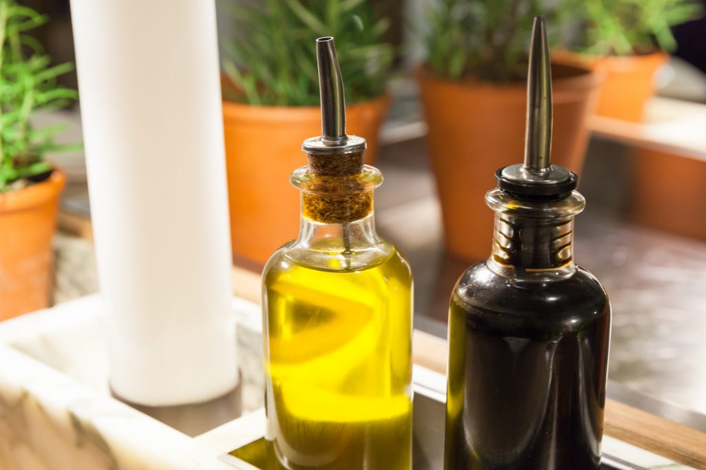 Olive oil and balsamic vinegar in glass bottles on a table in a restaurant